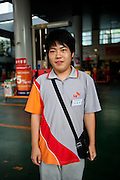 Daegu/South Korea, Republic Korea, KOR, 06.09.2009: A young man working at a petrol station in Daegu.
