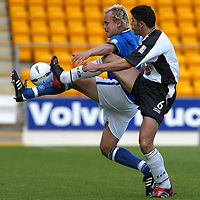 St Johnstone v Ayr Utd....04.10.03<br />Mixu Paatelainen and David Craig play footsie<br /><br />Picture by Graeme Hart.<br />Copyright Perthshire Picture Agency<br />Tel: 01738 623350  Mobile: 07990 594431