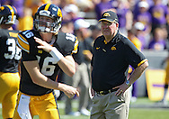 September 15 2012: Iowa Hawkeyes offensive coordinator Greg Davis watches as quarterback James Vandenberg (16) warms up before the start of the NCAA football game between the Northern Iowa Panthers and the Iowa Hawkeyes at Kinnick Stadium in Iowa City, Iowa on Saturday September 15, 2012. Iowa defeated Northern Iowa 27-16.
