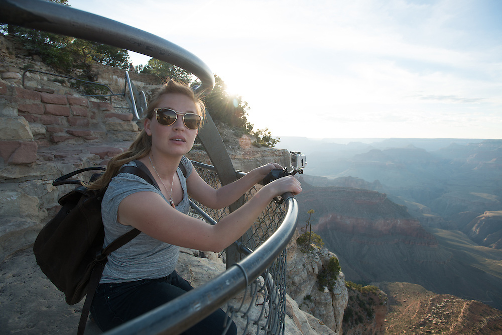 young woman documenting the Grand Canyon
