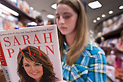 "23 NOVEMBER 2010 - PHOENIX, AZ:  TAMARA STATMAN, 13, from Phoenix, AZ, reads Sarah Palin's new book, ""America by Heart"" while waiting to get the book signed at a Barnes and Noble in Phoenix Tuesday. Statman, described herself as a political junkie and said she admires Palin and plans to run for president herself in 2044. Palin signed copies of her new book, ""America by Heart"" at the store in north Phoenix Tuesday night, Nov. 23. It was the kick off of her book tour to support America by Heart. Palin is frequently mentioned as a possible Republican candidate for US President in 2012.   Photo by Jack Kurtz"