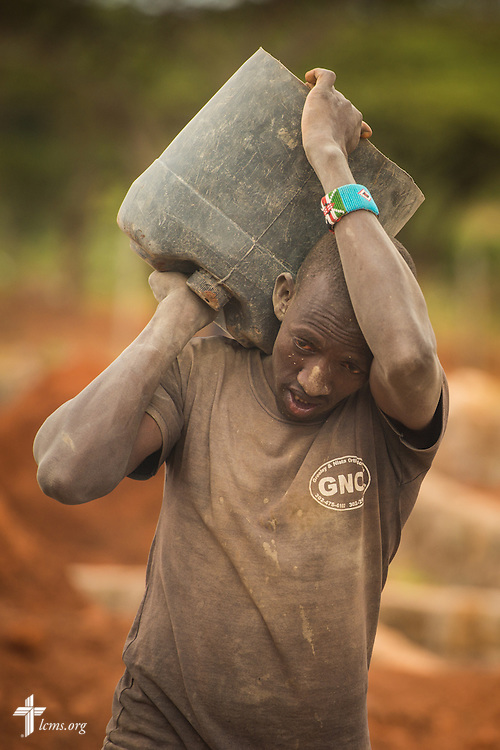 A worker helps build the Lenkishon ELCK (Evangelical Lutheran Church in Kenya) Project 24 site on Saturday, June 25, 2016, in Lenkishon, Kenya.  LCMS Communications/Erik M. Lunsford