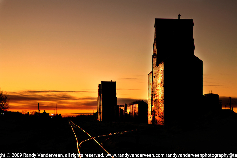 "Photo Randy Vanderveen.Grande Prairie, Alberta.Grain elevators in Sexsmith, Alberta are silhouetted against the colourful morning sky Tuesday, Jan. 20, 2009. The town, which was at one time known as ""The Grain Capital of the British Empire"", will be home to a new Viterra grain terminal which is set to begin construction this year."