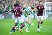 Tom Rogic(#18) of Celtic FC is tackled by Arnaud Djoum (#10) of Heart of Midlothian and Demetri Mitchell (#11)  of Heart of Midlothian during the Betfred League Cup semi-final match between Heart of Midlothian FC and Celtic FC at the BT Murrayfield Stadium, Edinburgh, Scotland on 28 October 2018.
