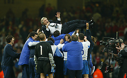 CARDIFF, WALES - Wednesday, November 19, 2003: Russia's players throw their coach Georgi Jartcev in the air in celebration after beating Wales 1-0 during the Euro 2004 Qualification Play Off match at the Millennium Stadium. (Pic by David Rawcliffe/Propaganda)