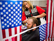04 FEBRUARY 2011 - PHOENIX, AZ: AMBER BILLINGS, from Phoenix, cuts the hair of homeless US Army vet at the Arizona StandDown in Phoenix Friday. The vet said it was his first haircut in about 10 years. The Arizona StandDown is an annual three day event that brings together the Valley's homeless and at-risk military veterans, connecting them with services ranging from: VA HealthCare, mental health services, clothing, meals, emergency shelter, transitional and permanent housing, ID/ drivers license's, court services and Legal Aide, showers, haircuts and myriad other services and resources.  Arizona StandDown is held annually at the Veterans Memorial Coliseum at the Arizona State Fairgrounds in Phoenix on Super Bowl weekend.    Photo by Jack Kurtz