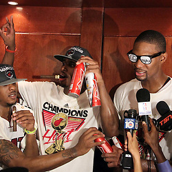 Jun 21, 2012; Miami, FL, USA; Miami Heat power forward Chris Bosh (right) celebrates in the locker room after winning the 2012 NBA championship at the American Airlines Arena. Miami won 121-106. Mandatory Credit: Derick E. Hingle-US PRESSWIRE