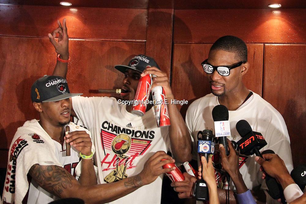 Jun 21, 2012; Miami, FL, USA; Miami Heat power forward Chris Bosh (right) celebrates in the locker room after winning the 2012 NBA championship at the American Airlines Arena. Miami won 121-106. Mandatory Credit: Derick E. Hingle-US PRESSWIRE