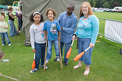 Family taking part in circus skills workshop at a Parklife summer activities event,