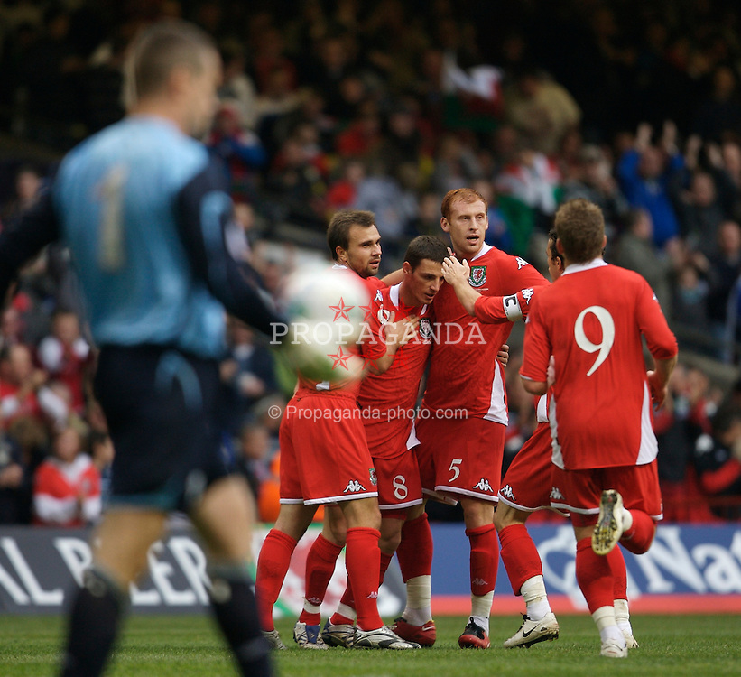 CARDIFF, WALES - Saturday, November 17, 2007: Wales' Jason Koumas celebrates scoring the opening goal against the Republic of Ireland with his team-mates Carl Fletcher, James Collins and Simon Davies during the UEFA Euro 2008 Qualifying Group D match at the Millennium Stadium. (Pic by David Rawcliffe/Propaganda)