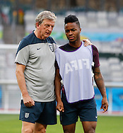England manager Roy Hodgson (L) speaks to Raheem Sterling of England during the England training session the day before their final Group D match against Costa Rica at Mineirão, Belo Horizonte, Brazil. <br /> Picture by Andrew Tobin/Focus Images Ltd +44 7710 761829<br /> 23/06/2014
