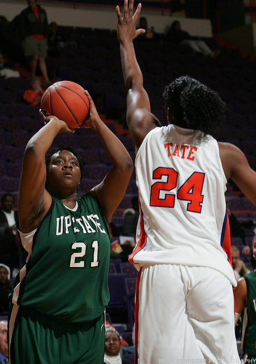 Dec 15, 2009; Clemson, SC, USA; USC-Upstate Spartans forward Chelsea McMillan (21) against the Clemson Tigers forward Jasmine Tate (24) during the second half at Littlejohn Coliseum. Mandatory Credit: Brian Schneider-www.ebrianschneider.com