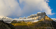 Lare evening light strikes the snow capped Garden Wall in Glacier National Park in Montana