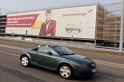 24.03.2015, Flughafen Köln Bonn, Köln, GER, Germanwings, Flugzeugabsturz 4U9525, im Bild Germanwings Werbung am Flughafen Koeln Bonn mit Auto im Vordergrund // An Airbus A320 of Germanwings has crashed in Southern French Alps on its flight from Barcelona to Duesseldorf International Airport, Germany, Pressconference at the Flughafen Köln Bonn in Köln, Germany on 2015/03/24. EXPA Pictures © 2015, PhotoCredit: EXPA/ Eibner-Pressefoto/ Schüler<br /> <br /> *****ATTENTION - OUT of GER*****