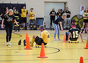 At left, Nicole Sanderson helps guide Micah Moen around the cones blinded folded while racing to beat their competition including Bailey Roden, second from right, guiding Briggs Havlik (25) during Mitchell High School's pep rally on Friday morning in the school's gym. (Matt Gade / Republic)