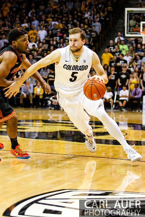 January 18th, 2014:  Colorado Buffaloes sophomore guard Eli Stalzer (5) drives the ball towards the basket in the second half of the NCAA Basketball game between the USC Trojans and the University of Colorado Buffaloes at the Coors Events Center in Boulder, Colorado