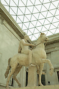 The Roman marble statue of a youth on horseback (c. 1st century AD) and possibly representing a prince of the ruling Julio-Claudian Dynasty, part of the Farnese Collection, now in the Great Court of the British Museum, on 28th February 2017, in London, England.