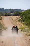 Road on the dry savannah plains of Serengeti, Tanzania, on the road to Lobo area.