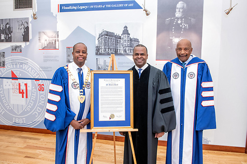 President Wayne A.I. Frederick, Kasim Reed, and Chairman of the Board Stacey Mobley with a Commencement citation.