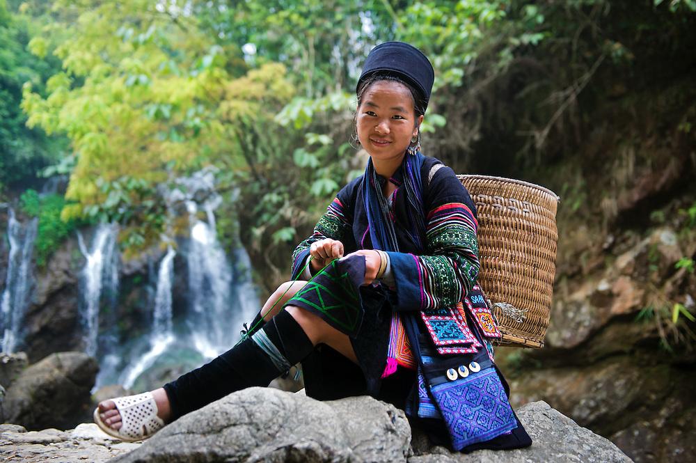 A Black Hmong woman sewing at Sapa, Vietnam.