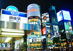 Evening view of bright lights on buildings in Ginza district of Tokyo