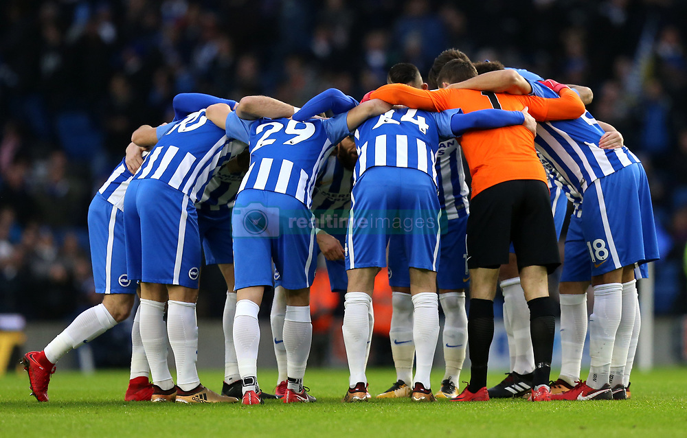 Brighton & Hove Albion players huddle prior to kick off during the Premier League match at the AMEX Stadium, Brighton.
