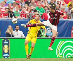 CHARLOTTE, USA - Saturday, August 2, 2014: Liverpool's Rickie Lambert in action against AC Milan's Adil Rami during the International Champions Cup Group B match at the Bank of America Stadium on day thirteen of the club's USA Tour. (Pic by Mark Davison/Propaganda)
