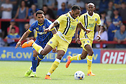 Tom Elliott and  Nadjim Abdou tussle during the Pre-Season Friendly match between AFC Wimbledon and Millwall at the Cherry Red Records Stadium, Kingston, England on 18 July 2015. Photo by Stuart Butcher.