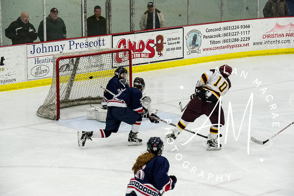 Lebanon's Emma Forman score's Lebanon's only goal during the second period of Tuesday's match against Oyster River in the NHIAA semi-final game at Concord's Everett Arena.  (Alan MacRae/Valley News)