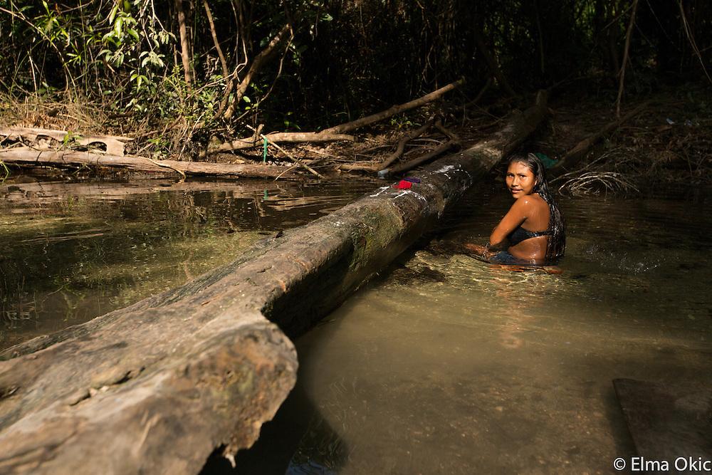 Local women bathing in the river at Sawre Muybu, a Munduruku indigenous community on the Tapajos River, Para, Brazil.