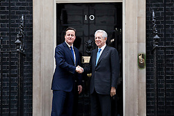 © Licensed to London News Pictures. 18/01/2012. LONDON, UK. The Italian Prime Minister, Mario Monti, meets the British Prime Minister, David Cameron, on the steps of Downing Street in London today (18/01/12). The par met today to discuss the current eurozone crisis. Photo credit: Matt Cetti-Roberts/LNP