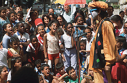 Clown entertaining group of children on the streets of Havana; Cuba,