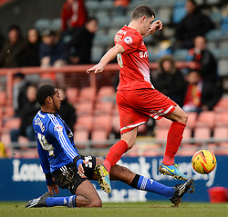 Swindon's Jamie Reckord and Orient's Lloyd James compete for the ball - Photo mandatory by-line: Mitchell Gunn/JMP - Tel: Mobile: 07966 386802 22/02/2014 - SPORT - FOOTBALL - Brisbane Road - Leyton - Leyton Orient V Swindon Town - League One