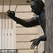 The pass-wall sculpture of Marcel Ayme in wall at Place Marcel Ayme by sculptor Jean Marais in Montmartre district, Paris, France<br />