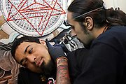 Artist tattoing the neck of a client during the 2nd International Tattoo Convention in London on Saturday, Oct. 7, 2006, in London, UK. With over 15.000 visitors in three days during the 2005 edition, the event placed London in a central position in the tattoo world.  This year about 150 artists ,representing all the tattoo styles, are ticking away with their machines in a very exciting atmosphere. **ITALY OUT**....