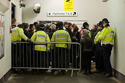 © under license to London News Pictures.  11/12/2010 Exeter fans wait for a train under police escort after the Devon derby between Exeter and Plymouth today (Saturday). Large numbers of police were present after violence broke out at the last derby. Picture credit should read: David Hedges/LNP