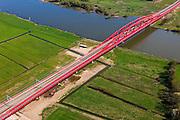 Nederland, Gelderland - Overijssel, Hattem, 01-05-2013; IJsselbrug, spoorbrug bij Hattem voor de Hanzelijn. Westoever.<br /> De 'Hanzeboog' is ontworpen door  Quist Wintermans Architecten.<br /> The red railway bridge Hanzeboog (Hanseatic arch) over the IJssel near Zwolle, has been designed by Quist Wintermans Architects.  <br /> luchtfoto (toeslag op standard tarieven);<br /> aerial photo (additional fee required);<br /> copyright foto/photo Siebe Swart