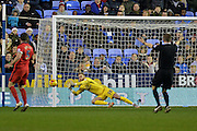 Blackburn Rovers goalkeeper Jason Steele makes a save during the Sky Bet Championship match between Reading and Blackburn Rovers at the Madejski Stadium, Reading, England on 3 December 2015. Photo by Mark Davies.