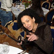 NLD/Amsterdam/20060131 - BN'er hondendiner, protest tegen gebruik proefdieren, Paula Undondek en hond aan tafel