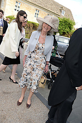 JILLY COOPER at the wedding of Lady Natasha Rufus Isaacs to Rupert Finch held at St.John The Baptist Church, Cirencester, Gloucestershire, UK on 8th June 2013.