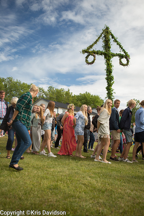 Revelers dancing around the Midsummer maypole on Öland, a Swedish island in the Baltic Sea. The longest day of the year is a beloved holiday in Sweden; the cities are empty as the locals take to the countryside for a day of dancing and singing with family and friends.