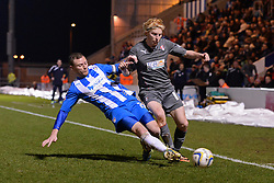 Colchester's Brian Wilson and Rotherham's Ben Pringle compete for the ball  - Photo mandatory by-line: Mitchell Gunn/JMP - Tel: Mobile: 07966 386802 04/03/2014 - SPORT - FOOTBALL - Colchester Community Stadium - Colchester - Colchester v Rotherham - Sky Bet League 1