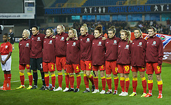 LONDON, ENGLAND - Saturday, October 26, 2013: Wales players line-up before the FIFA Women's World Cup Canada 2015 Qualifying Group 6 match against England at the New Den. L-R: Jess Fishlock, Nicola Davies, Loren Dykes, Helen Bleazard, Kylie Davies, Sophie Ingle, Angharad James, Hayley Ladd, Sarah Wiltshire, Natasha Harding, Helen Ward (nee Lander). (Pic by David Rawcliffe/Propaganda)