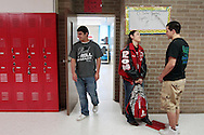 "Senior Luis ""Yayo"" Torres (right) walks his girlfriend, junior Mariela Navarro, to her class May 30, 2012 on the last day of school at Premont High School."