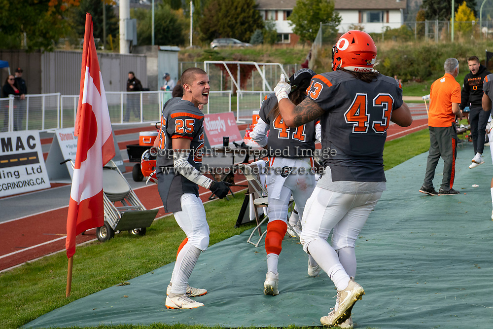 KELOWNA, BC - OCTOBER 6: Keagan Proudlock #25 celebrates on the sidelines with Will Kuyvenhoven #43 of Okanagan Sun against the VI Raiders at the Apple Bowl on October 6, 2019 in Kelowna, Canada. (Photo by Marissa Baecker/Shoot the Breeze)