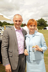 Asprey World Class Cup polo held at Hurtwood Park Polo Club, Ewhurst, Surrey on 17th July 2010.<br /> Picture shows:- ALEXANDER & LUDMILA BULOCHNIK he is first deputy chairmen of the management board, Master Bank.