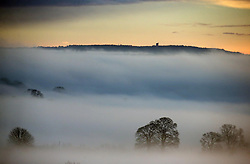 © Licensed to London News Pictures. 26/12/2013. EVERCREECH, UK . King Alfred's tower at Stourhead surrounded by mist at dawn taken from Evercreech in Somerset this morning 26th December 2013. Picture : Jason Bryant/LNP