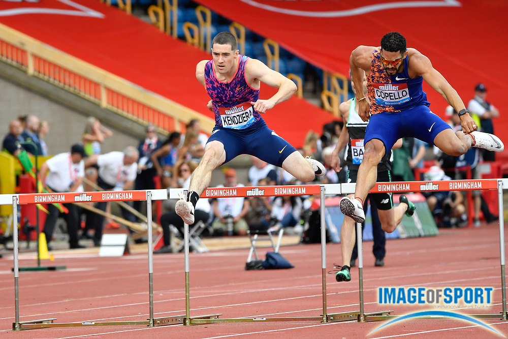 Yasmani Copello (TUR), right, leads David Kendziera (USA) on his way to winning the men's 400m hurdles in a time of 49.08 during the Birmingham Grand Prix, Sunday, Aug 18, 2019, in Birmingham, United Kingdom. (Steve Flynn/Image of Sport)
