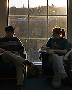 The sun sets behind a pair of studying students in O.U.'s new Baker Center on Tuesday, 1/08/07.