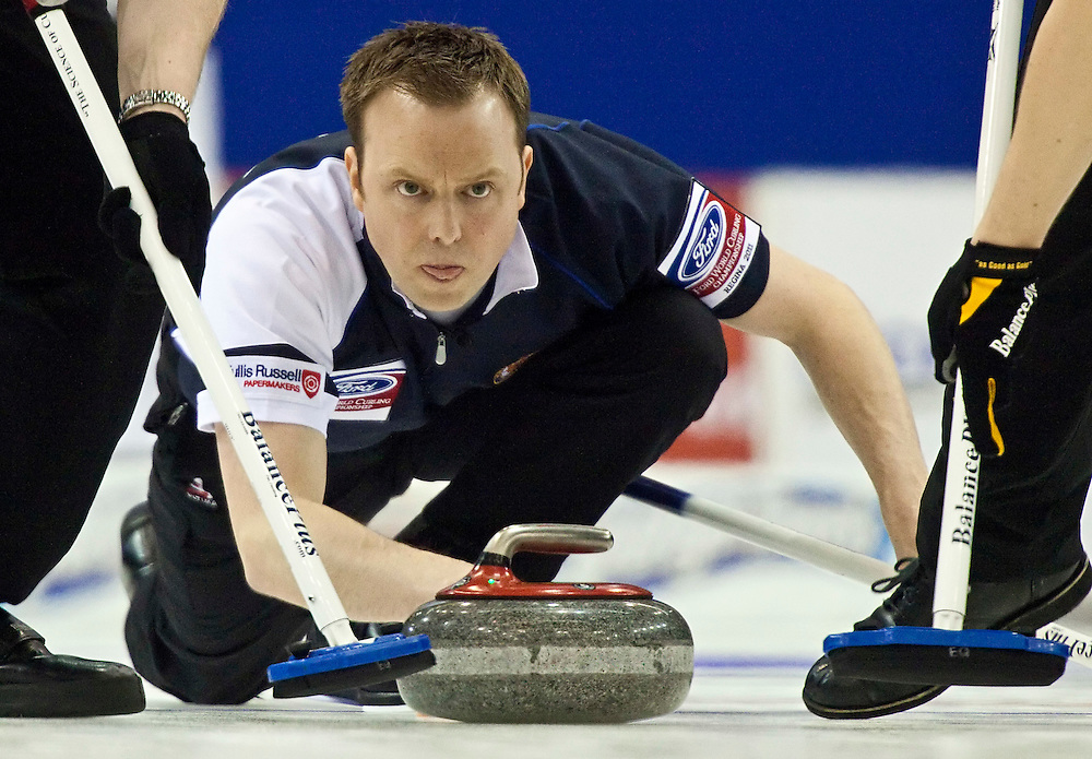 Scottish skip Tom Brewster releases his stone during the gold medal game against Canada at the Ford World Men's Curling Championships in Regina, Saskatchewan, April 10, 2011.<br /> AFP PHOTO/Geoff Robins